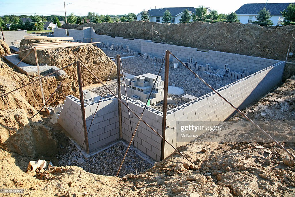 Construction of a basement wall before backfill stock for Best backfill material for foundation
