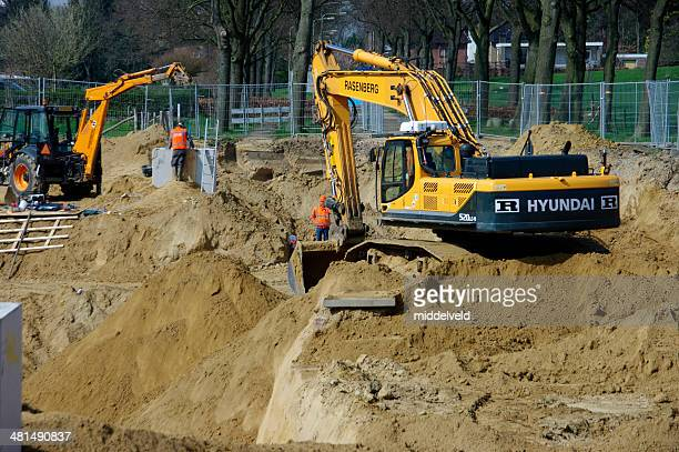 construction of a new country road - crane construction machinery stock pictures, royalty-free photos & images