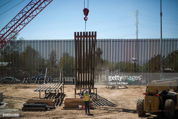 Construction of a new fence takes place as US Department of Homeland Security Secretary Kirstjen M Nielsen tours a replacement border fence...