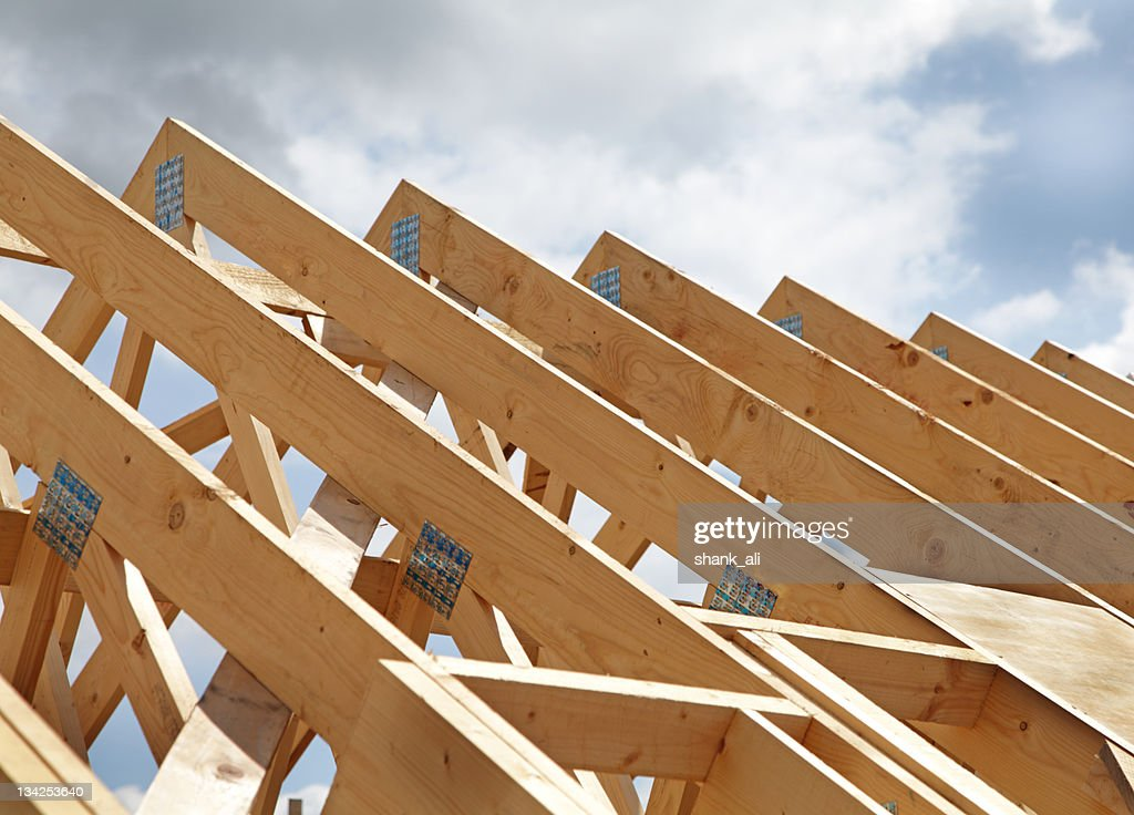 Construction of a wooden roof frame underway : Stockfoto