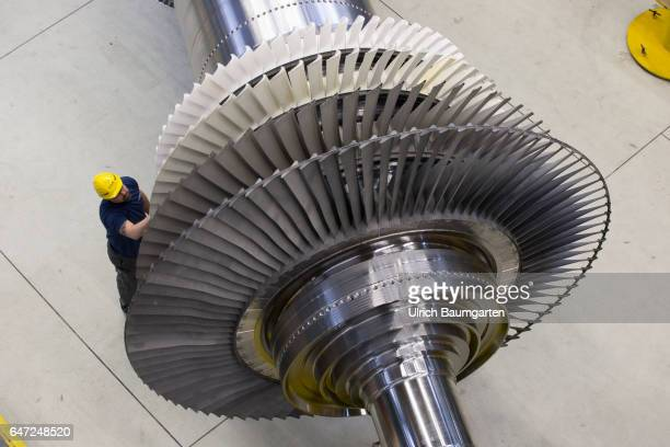 Construction of gas turbines at Siemens AG in Berlin Technician working on components of a gas turbine