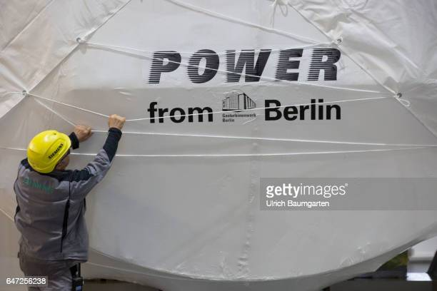 Construction of gas turbines at Siemens AG in Berlin Technician examines the packaging of a gas turbine with the inscription Power from Berlin