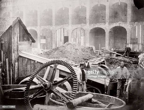Construction of Holborn Viaduct, City of London, 1869. View of figures standing near a mortar mill at the south west end of Holborn Viaduct.