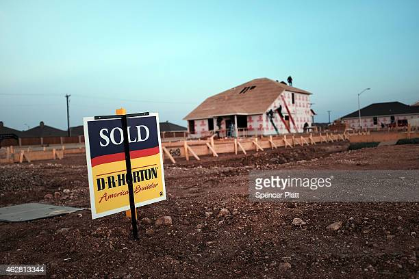 Construction of homes continues at a brisk pace in Midland despite dramatic falls in the price of oil on February 5 2015 in Midland Texas As crude...