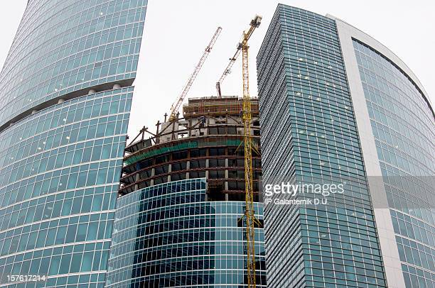 construction of modern office buildings in downtown. - crane construction machinery stock pictures, royalty-free photos & images