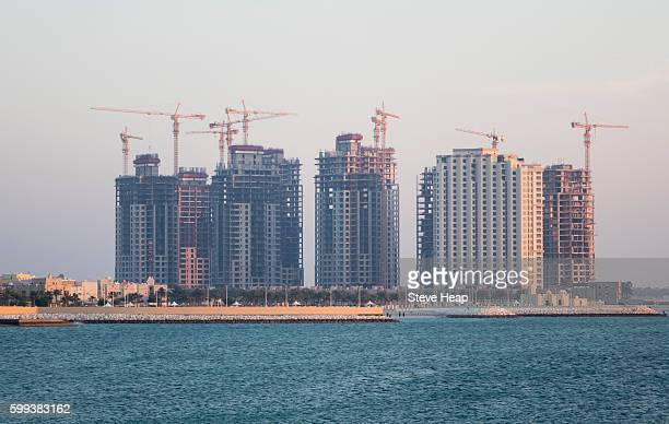 construction of new apartment buildings near the royal palace in budaiya, bahrain - waterfront stock pictures, royalty-free photos & images