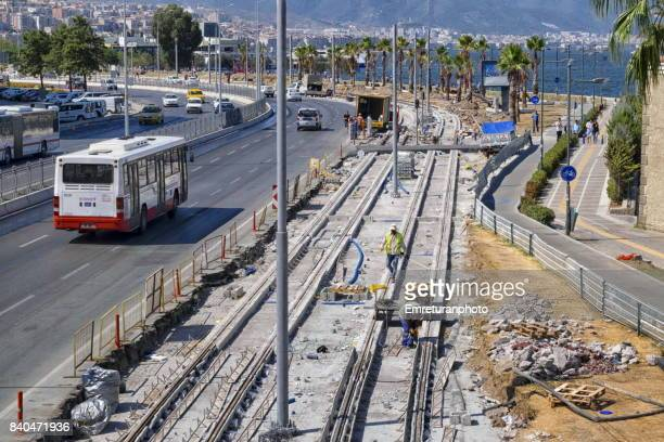 construction of new tram lines at konak,izmir. - emreturanphoto stock pictures, royalty-free photos & images