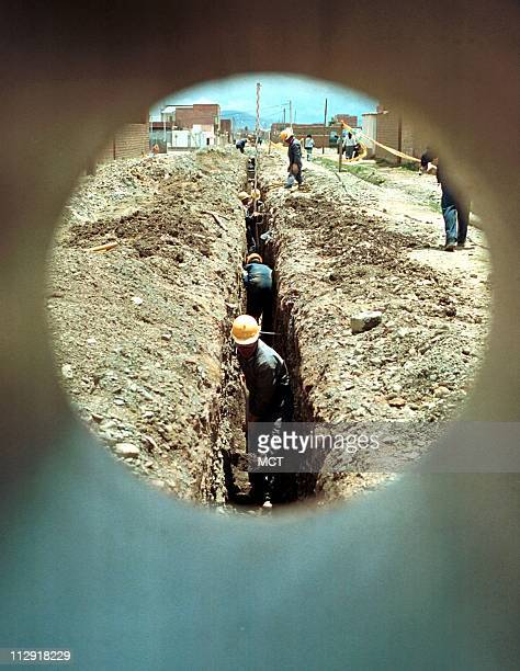Construction of part of a potable water network by French company Suez in El Alto city the poorest city of Bolivia near La Paz To antiglobalization...