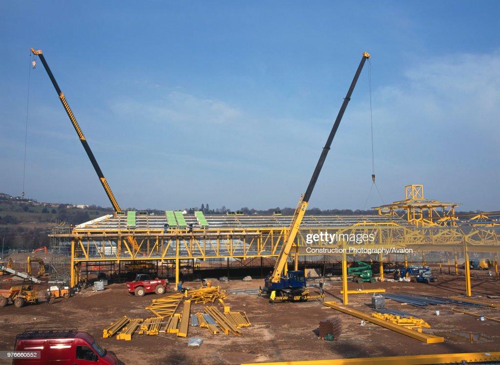 Construction of steel frame building for new supermarket. Crane ...