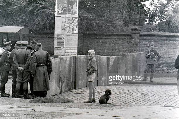 Construction of the Berlin Wall at the corner Bernauer Strasse / Ackerstrasse