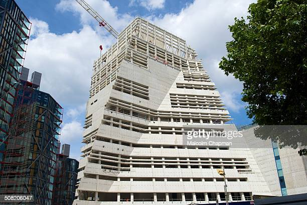 CONTENT] Construction of the Tate Modern extension project at Bankside on the South Bank London UK The Herzog de Meuron designed 10 story tower...