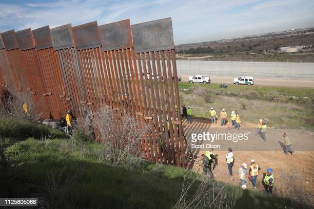 Construction of the US border wall is halted after a car rolled down an embankment and landed against the wall on the Mexican side of the border on...