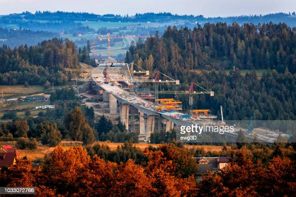 construction of the viaducts on the new s7 highway, skomielna biala, poland - road construction stock photos and pictures