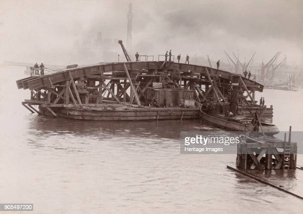 Construction of Vauxhall Bridge London 19031904 Barges manoeuvring one of the steel arches which would form the new Vauxhall Bridge into place on the...