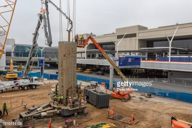 Construction on a multi-billion-dollar airport renovation project continues during stay-at-home orders next to Tom Bradley International Terminal at...