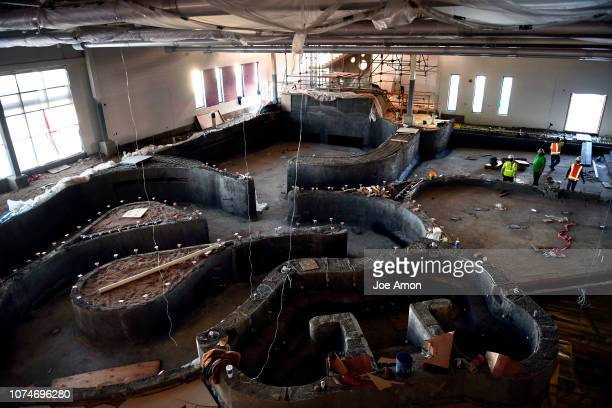 Construction on the Central Recreation Center's lazy river with the indoor wave pool and water slide in the background December 14, 2018 in Aurora,...