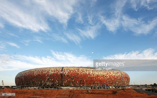 Construction on the Soccer City Stadium, previously known as the FNB Stadium, for the 2010 Soccer World Cup is nearly complete, as seen on may 15,...