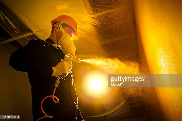 Construction painter with spray gun