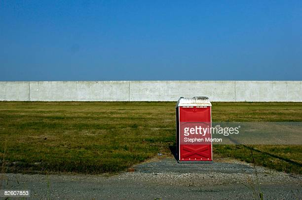 A construction portapotty stands in front of the new levee near the Ninth Ward August 30 2008 in New Orleans Louisiana With hurricane Gustav...