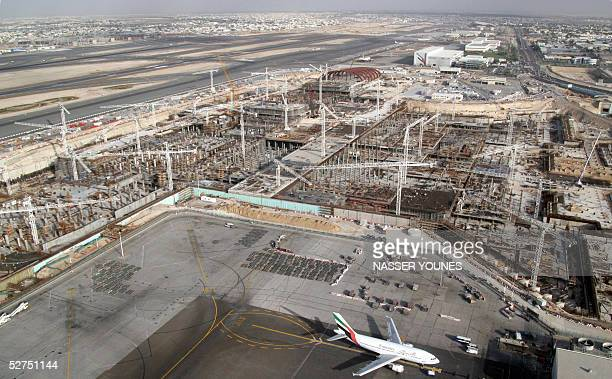 Construction pushes ahead on the airport extension in Dubai 05 April 2005 A huge construction drive underway is designed to consolidate the status of...