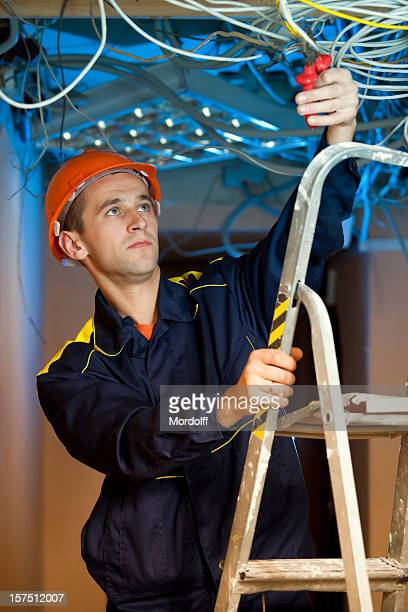 Construction repairman on stepladder