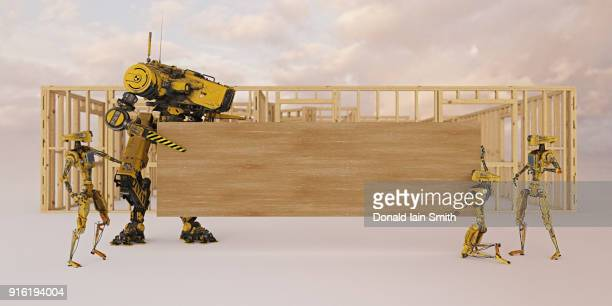 Construction robots holding wooden board with copy space