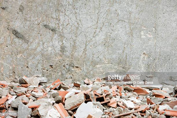 construction rubble, broken bricks, pieces of concrete against wall - rubble stock pictures, royalty-free photos & images