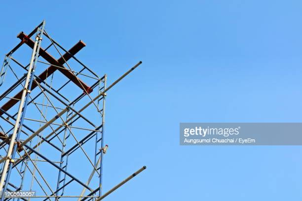 construction scaffolding. copy space with blue sky background. industrial and construction concept. - aungsumol stock pictures, royalty-free photos & images