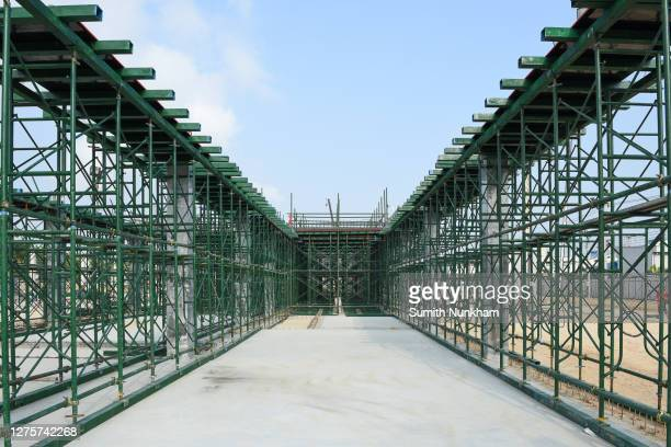 construction scaffolding for support structure building second beam and second floor at construction site - fabricage apparatuur stock pictures, royalty-free photos & images