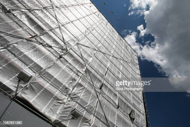 construction scaffolding on facade in berlin, germany - rebuilding stock pictures, royalty-free photos & images