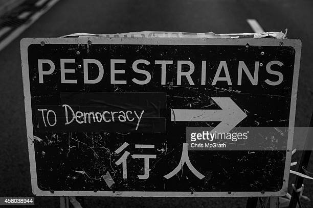 A construction sign used at barricades by prodemocracy activists is seen on the street outside the Hong Kong Government Complex on October 29 2014 in...