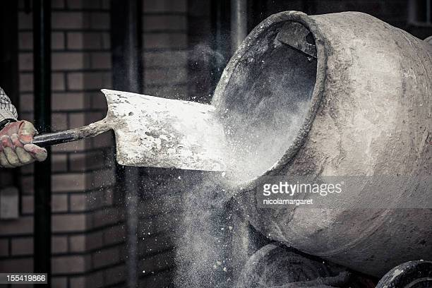 construction site:  adding lime to cement - cement stock pictures, royalty-free photos & images