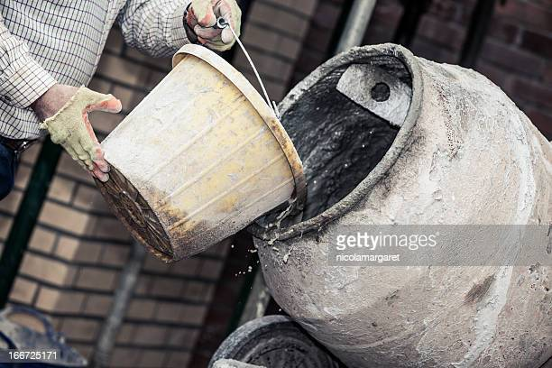 construction site:  adding water to cement - mixing stock pictures, royalty-free photos & images