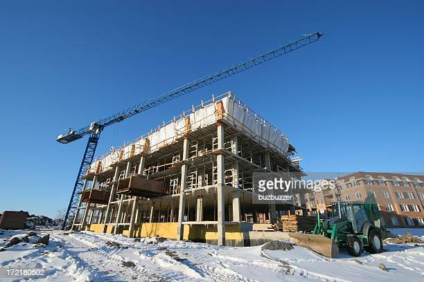 construction site and crane in winter - crane construction machinery stock pictures, royalty-free photos & images