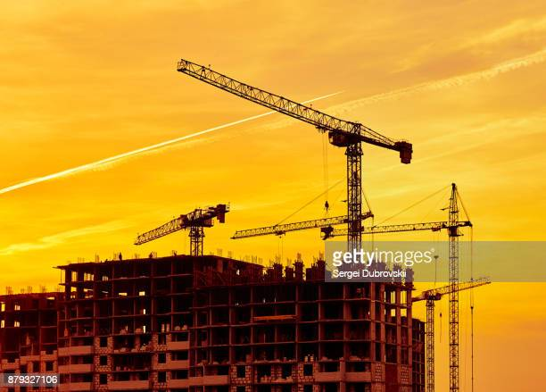 construction site at dusk evening yellow light, crane - foundation make up stock pictures, royalty-free photos & images