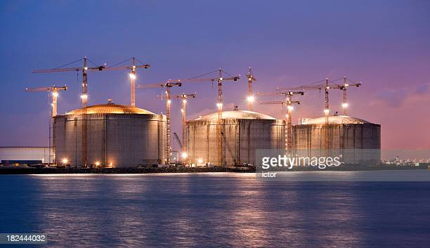 construction site at night - fuel storage tank stock photos and pictures
