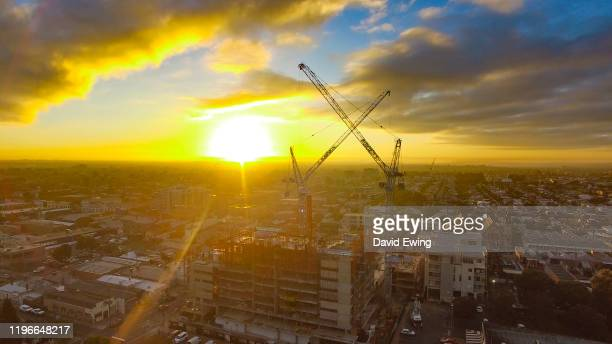 construction site at sunrise - david ewing stock pictures, royalty-free photos & images