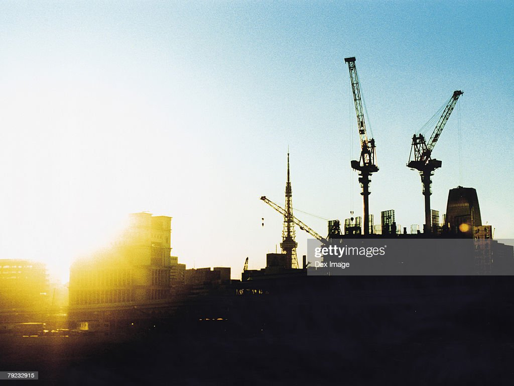 Construction site at sunset, silhouette : Stock Photo