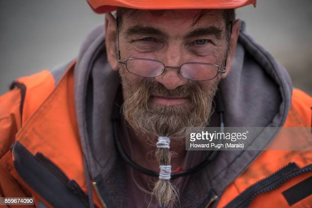 Construction site character. Braided Bearded Construction Worker