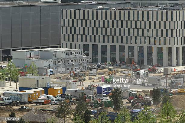Construction site containers stand stacked at the the construction site of the new Willy Brandt Berlin Brandenburg International Airport on May 8...