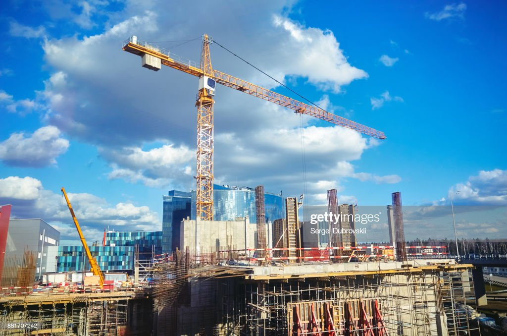 Construction site crane at blue sky background : Stock Photo