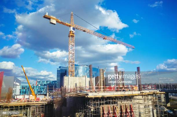 construction site crane at blue sky background - crane stock pictures, royalty-free photos & images