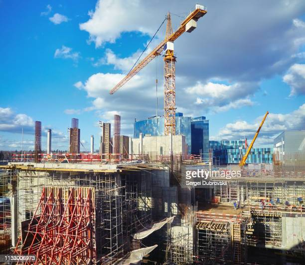 construction sit,e crane, blue cloudy sky - construction site stock pictures, royalty-free photos & images