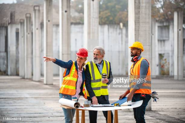 construction site developers working on plans - design occupation stock pictures, royalty-free photos & images