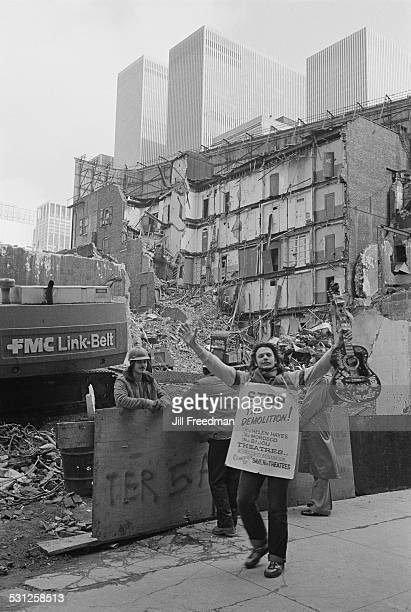 A construction site in New York City circa 1976 A protestor with a 'Stop the Demolition' sign campaigns to 'Save the Theatres'