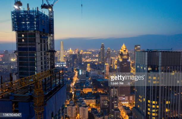 construction site in the city - liyao xie stock pictures, royalty-free photos & images