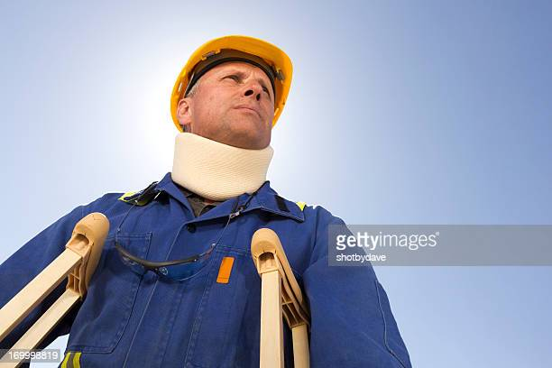 construction site injury - crutches stock photos and pictures