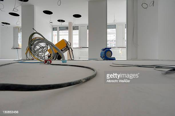 construction site, interior, drying equipment with electricity cables, drying out the rooms - techniker stock pictures, royalty-free photos & images