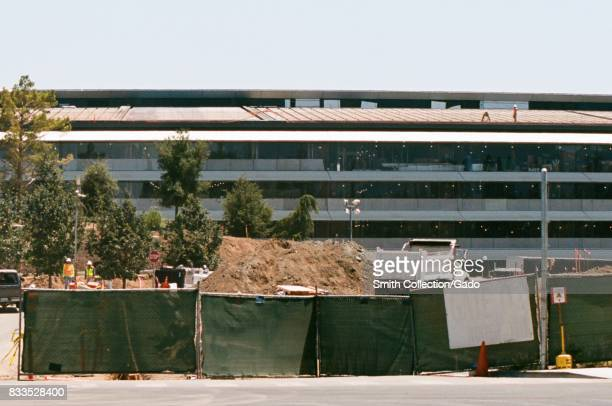 A construction site is visible in front of the main building at the Apple Park known colloquially as 'The Spaceship' the new headquarters of Apple...