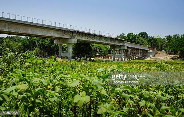 Construction site of a bridge that is being built to improve the rural infrastructure by a river on April 10 2016 in Narikelbari Bangladesh